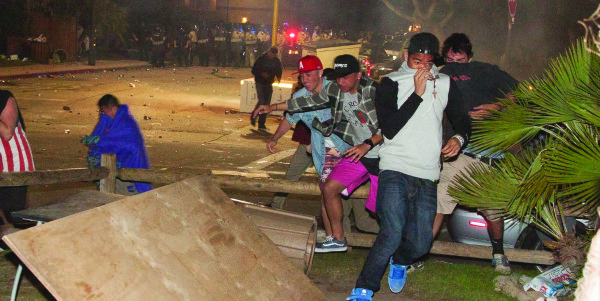 Police officers in riot gear deployed tear gas, foam and rubber bullets, a long-range-acoustic device and more in order to disperse crowds on and around Del Playa Drive. Residents were ordered to remain inside.