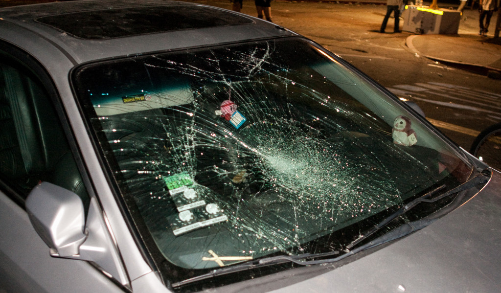 Homes and vehicles, like this one here, were damaged during the riots at night. Robert Johnson/Daily Nexus