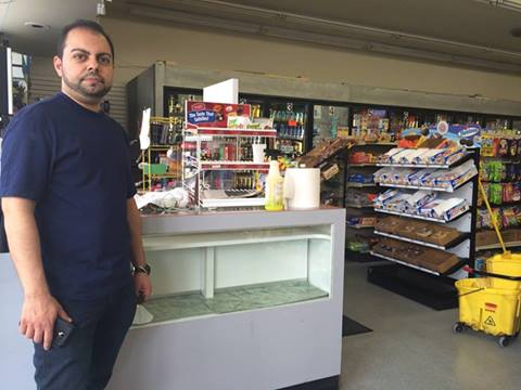 V Deli Mart Owner Michael Hassan stands inside his store, in the same area where one victim was shot dead last night.V Deli Mart Owner Michael Hassan stands inside his store, in the same area where one victim was shot dead last night.