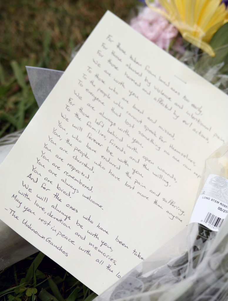 A letter left Saturday alongside long-stemmed roses on the lawn of the Alpha Phi sorority house, where Rodger claimed his first two victims. (Erika Martin / Daily Nexus)