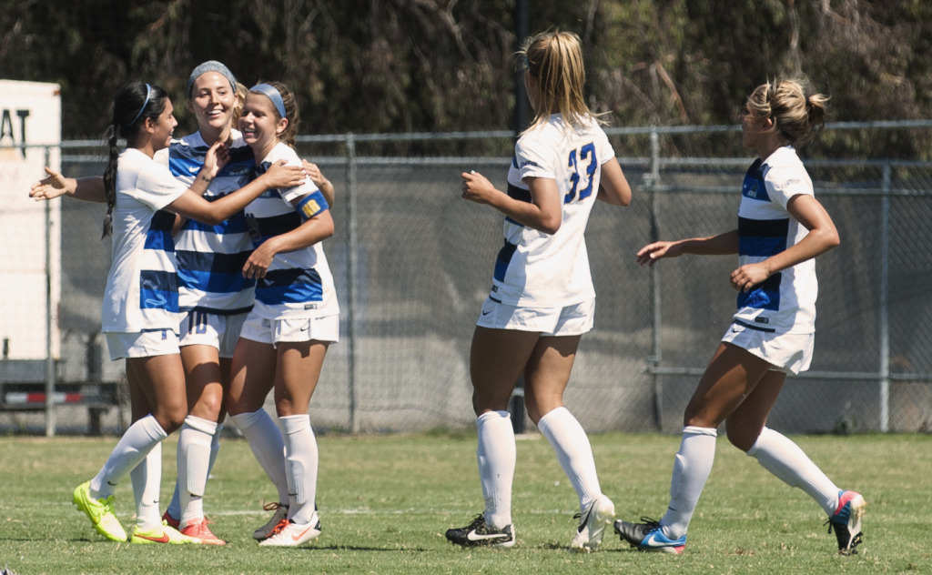 UCSB's squad celebrates the first of their four goals against Duquesne on a balmy Sunday afternoon. The Gauchos, who have now won five matches in a row, will open Big West play against CSU Northridge on Friday. Kenneth Song/Daily Nexus