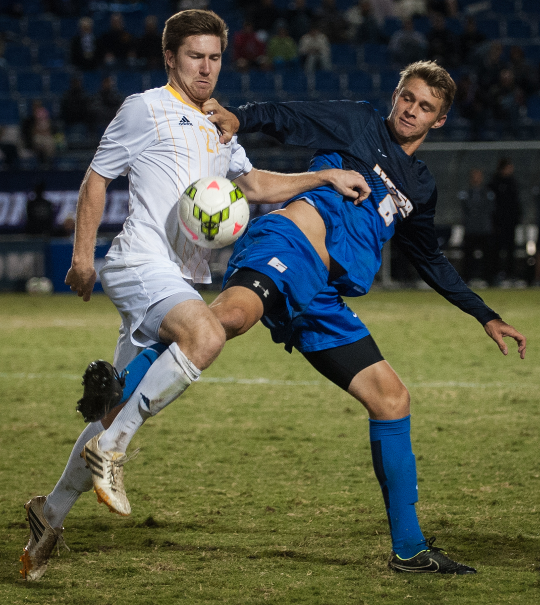 Defender Jack Birkenbeuel (left) and Nick DePuy struggle for the ball during the first half of the match. (Kenneth Song/Daily Nexus)