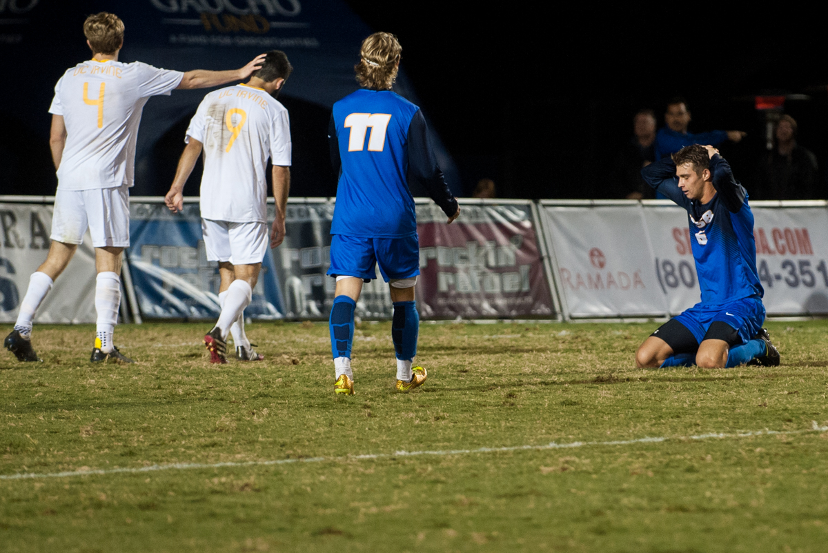 Nick DePuy (6, far left) kneels on the grass in disbelief after he missed the goal on a 1v1 opportunity. Conversely, UCI defender Matthew Tilley (4) expresses his relief to his teammate Mitchell Alvarez (9). (Kenneth Song/Daily Nexus)