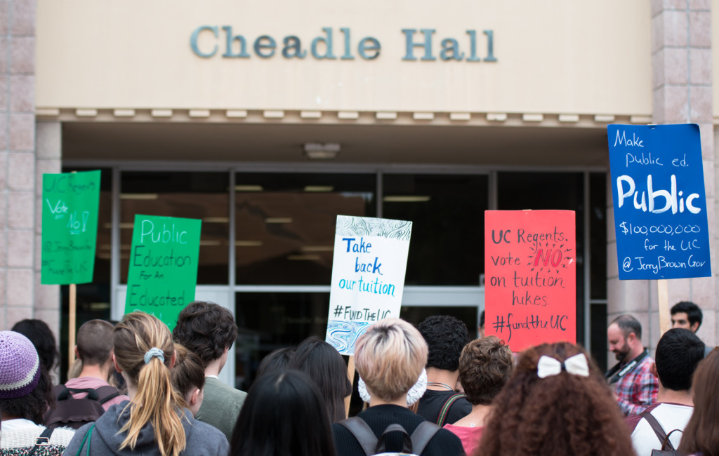 Protesters chant outside of Cheadle Hall after a rally against UC tuition increase that took place Thursday in Storke Plaza. Stephen Manga/Daily Nexus