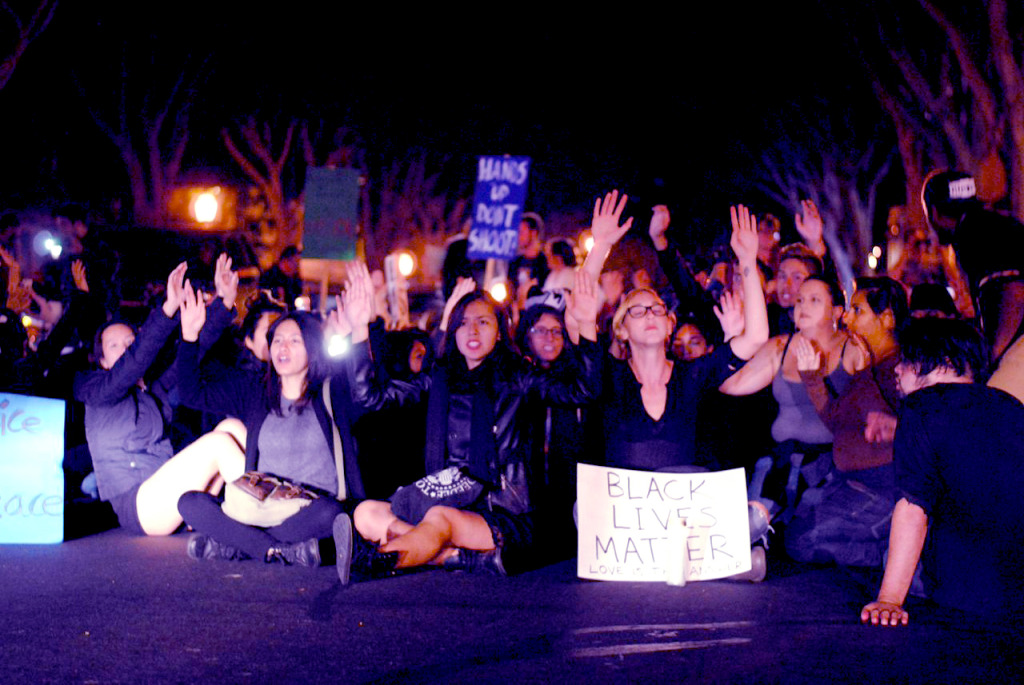 Roughly 500 Santa Barbarans marched throughout the streets of downtown Santa Barbara in protest of the St. Louis County grand jury decision not to bring criminal charges to Ferguson police officer Darren Wilson. Christina DeMarzo/Daily Nexus