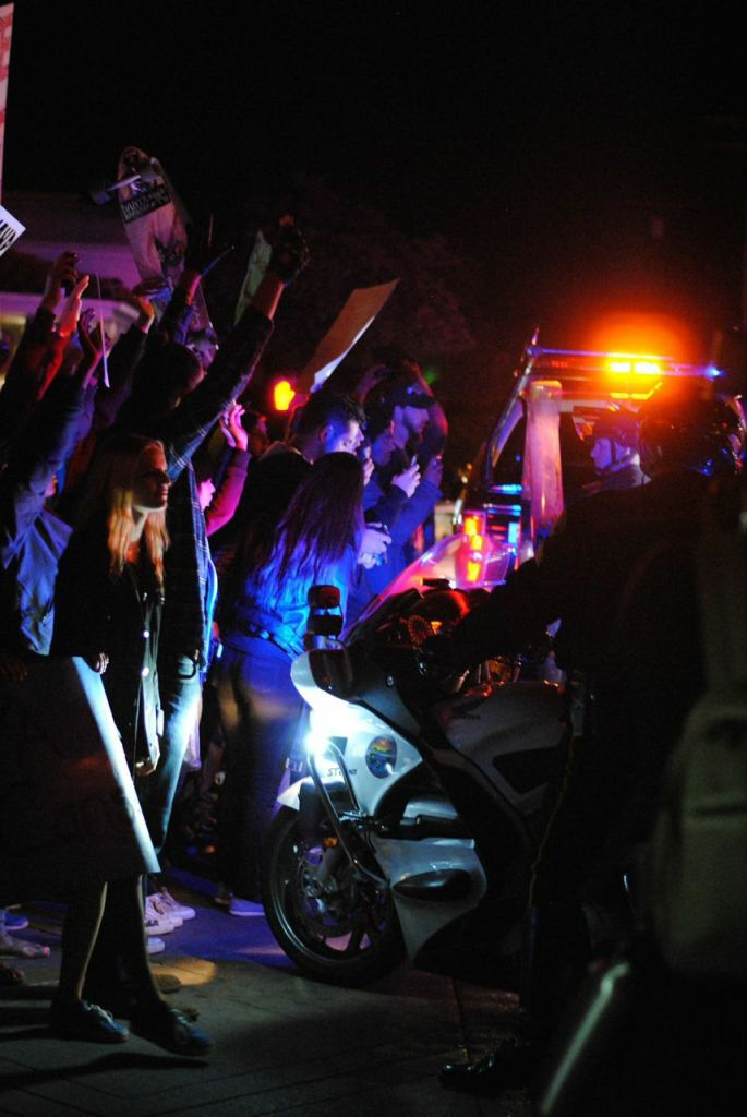 Santa Barbara Police Dept. officers blockaded protesters trying to block freeway traffic using riot shields, an armored car and police vehicles. Christina DeMarzo/Daily Nexus