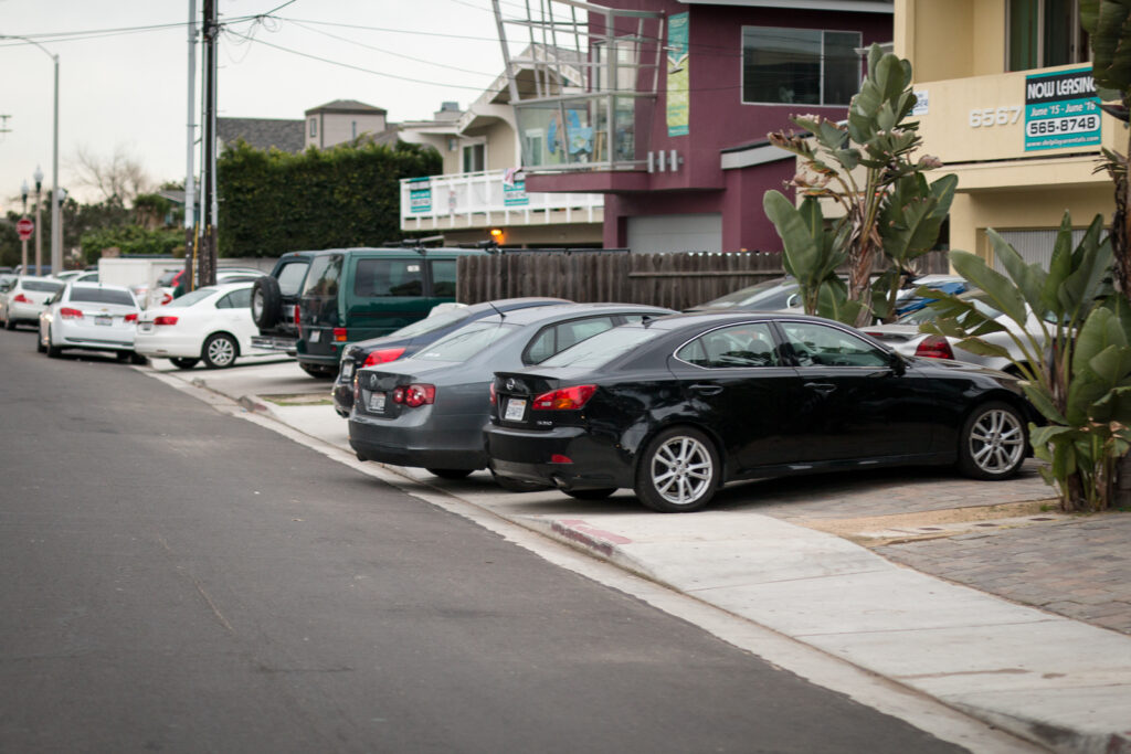Vehicles parked in a manner that is on or blocking sidewalks will soon be cited by Isla Vista Foot Patrol. Stephen Manga/Daily Nexus