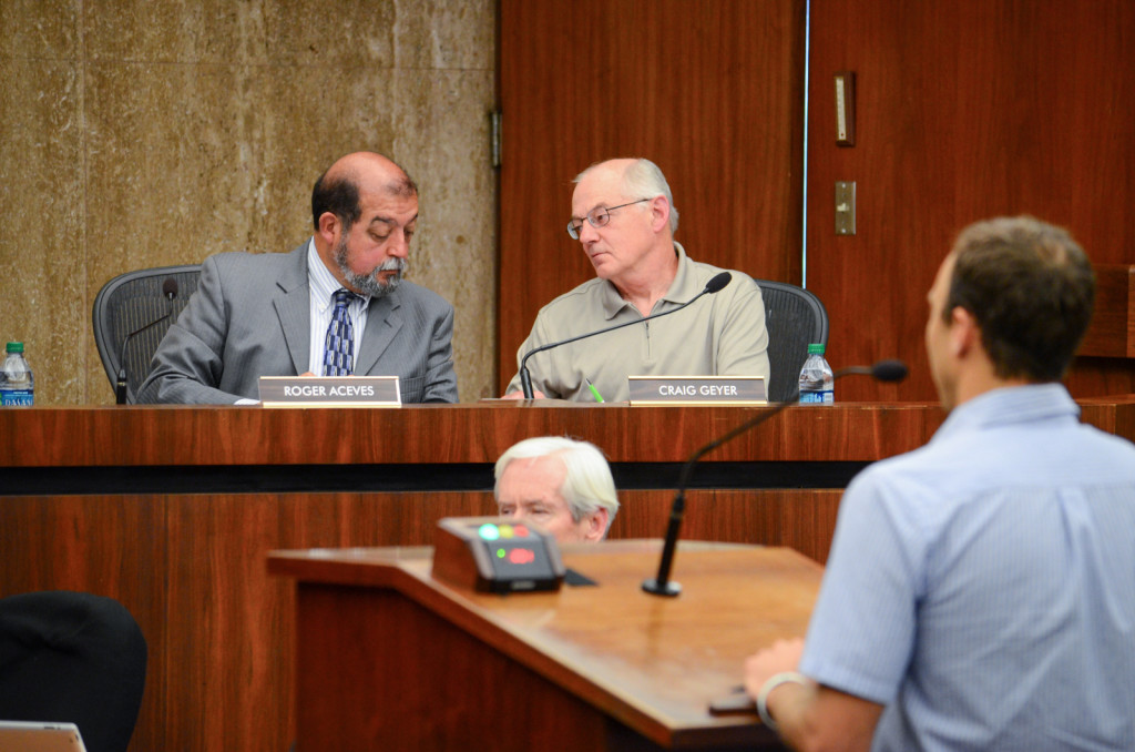 Roger Aceves and Craig Geyer compare notes as they listen to a community member speak. Christina DeMarzo/Daily Nexus