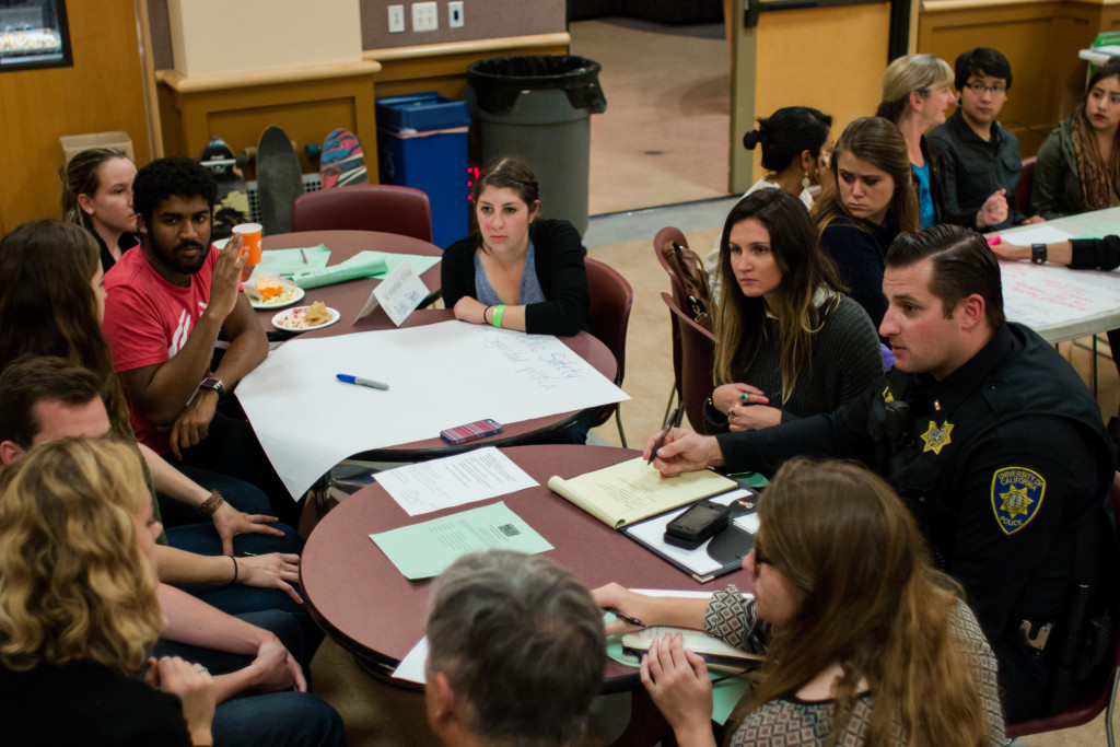 The public safety group discusses opinions while the officer takes notes. Stephen Manga/Daily Nexus