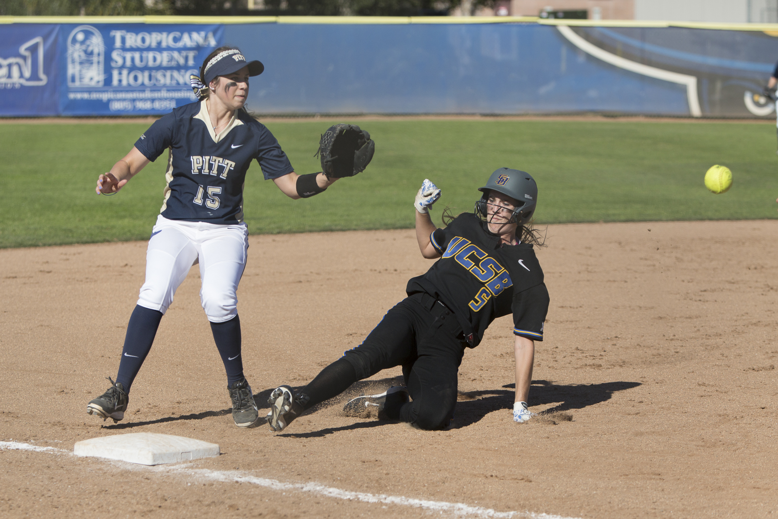 Jessica Johnston slides into third base right before the ball. Dustin Harris/Daily Nexus