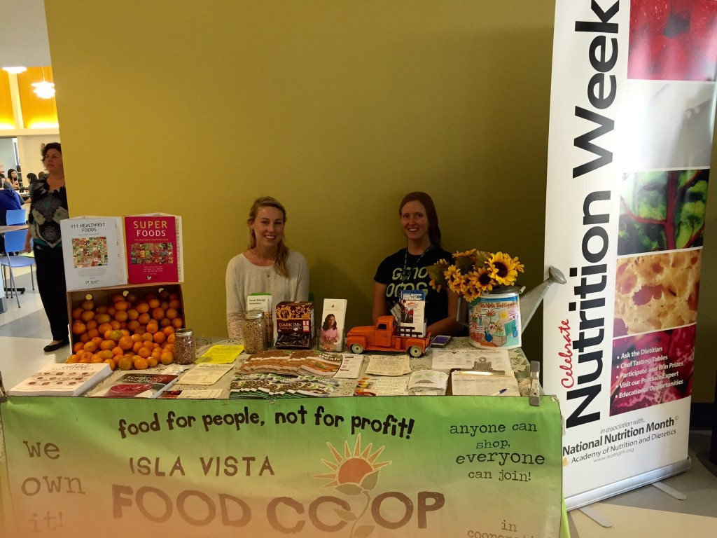 Kelsey Coney (left) and Ashley Audycki (right) represent Isla Vista Food Co-op at a 2015 Nutrition Week table at Carrillo Dining Commons.