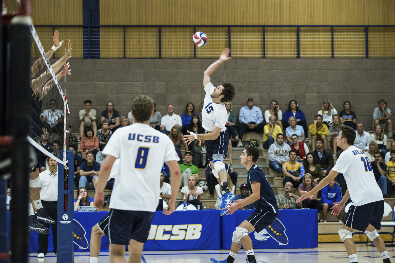 Kevin Donohue swings an opposite hit just over the block. Eric Swenson/Daily Nexus