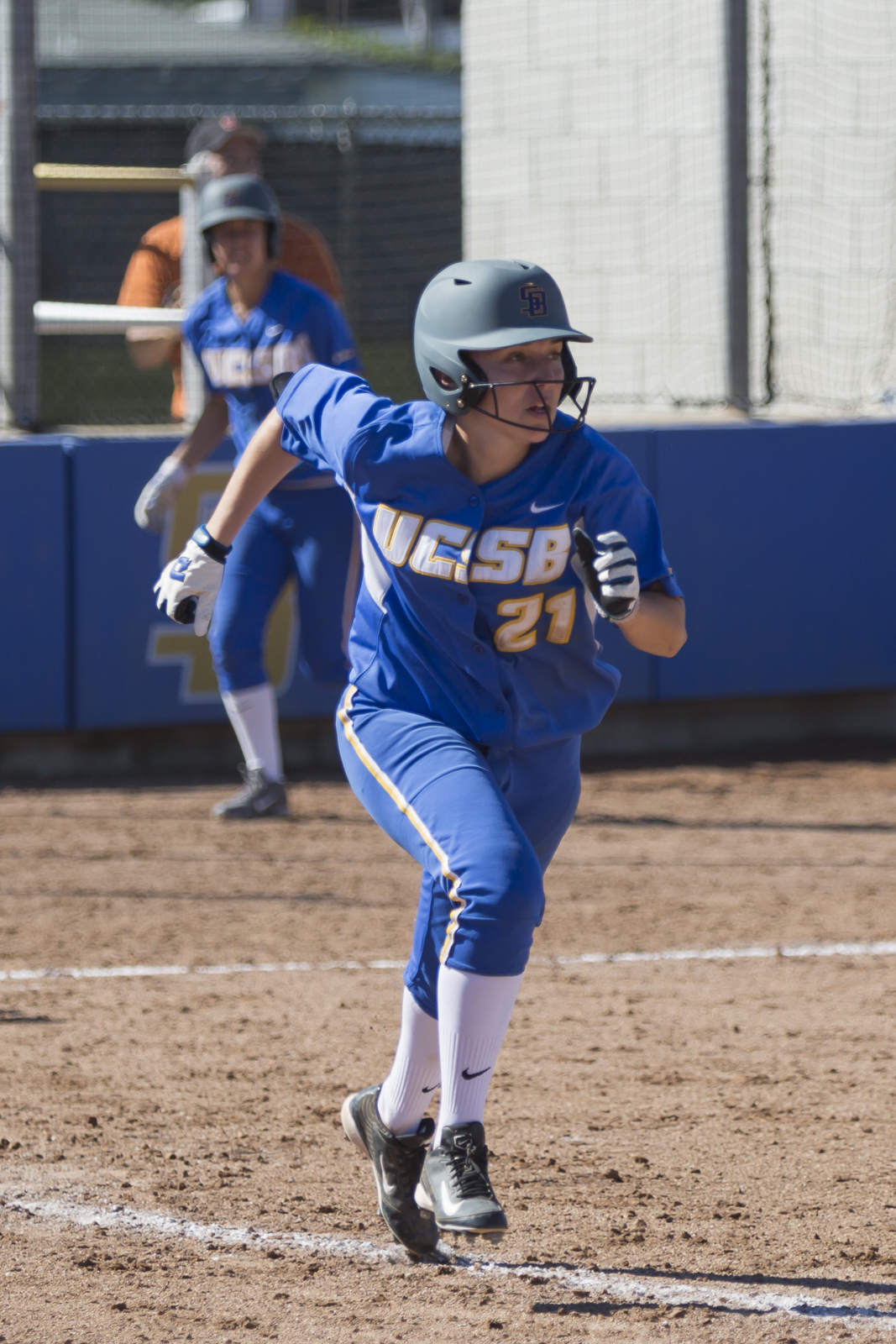 After hitting the ball, Arianna Palomares sprints to first base. Dustin Harris/Daily Nexus