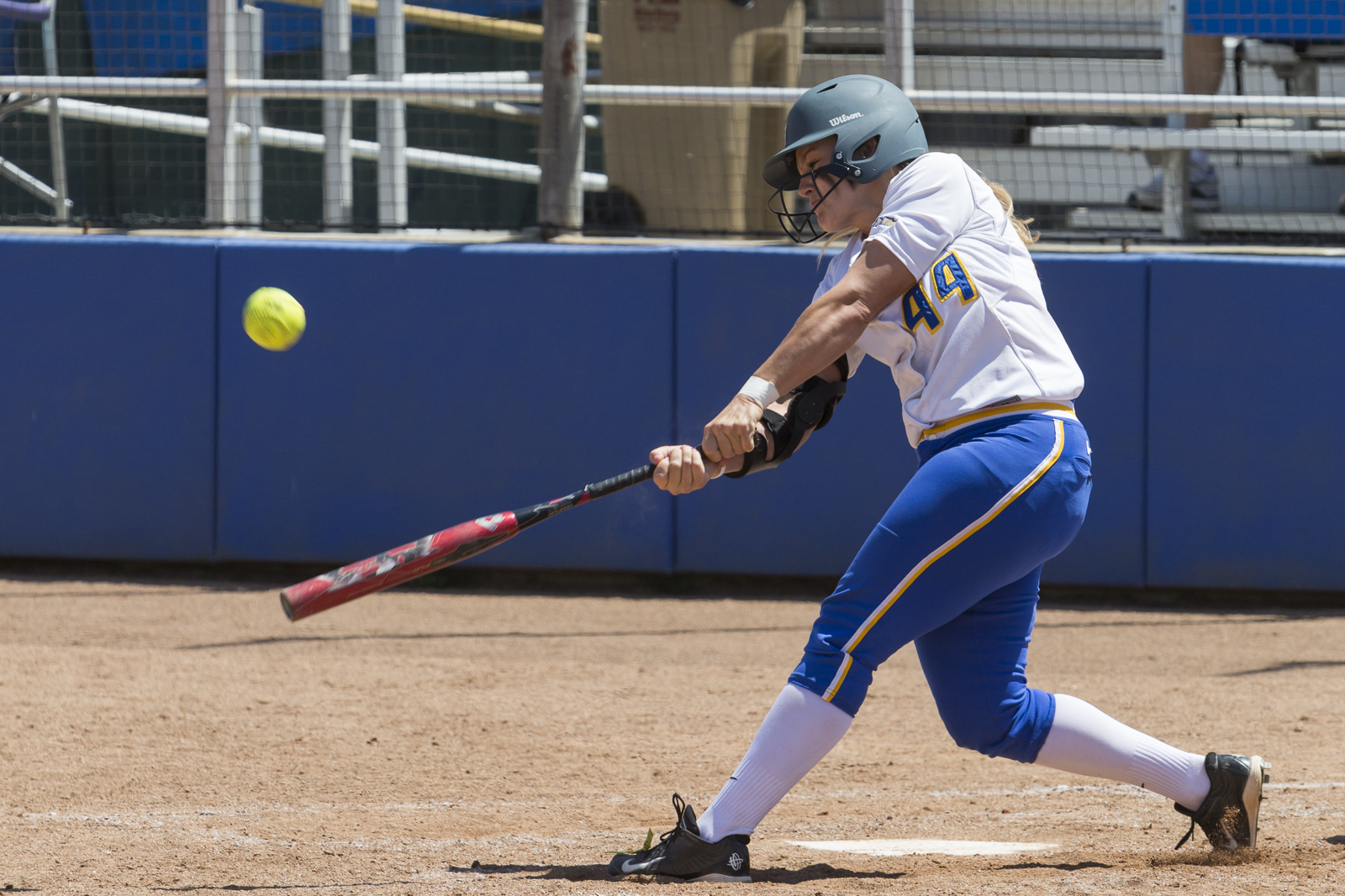 Senior Shelby Wisdom connects with a pitch, sending it flying. Dustin Harris/Daily Nexus