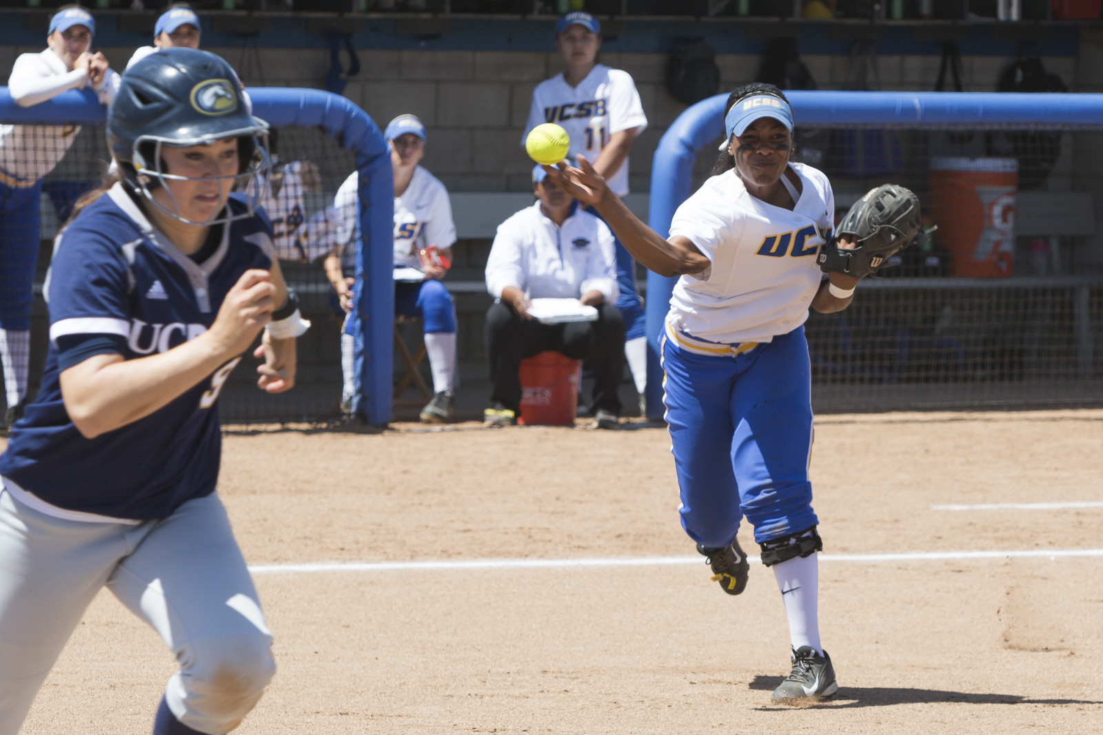 Attempting to beat the runner, DeJanee Moore hurls the ball to first base. Dustin Harris/Daily Nexus