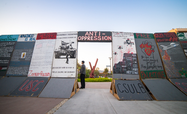 Originally assembled at UCI in 2012, the mural has been transferred to and displayed on college campuses as far as UC Berkeley and Arizona State University. The wall seeks to encourage discussion on the Palestine/Israel conflict, though some students have expressed concerns it does not represent multiple viewpoints. Lorenzo Basilio/Daily Nexus