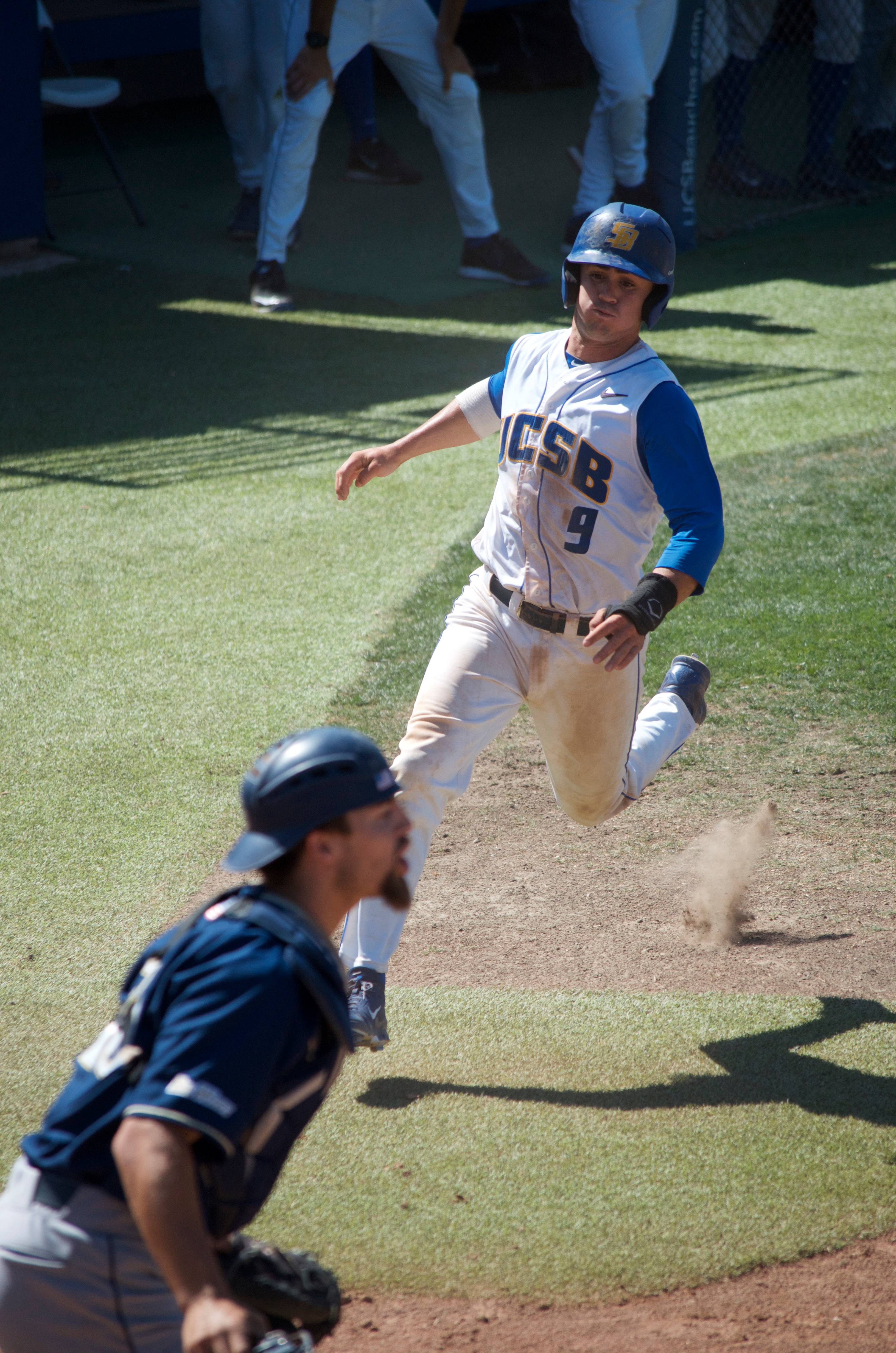 Woody Woodward runs into home plate, scoring a point for the Gauchos. Christina DeMarzo/Daily Nexus