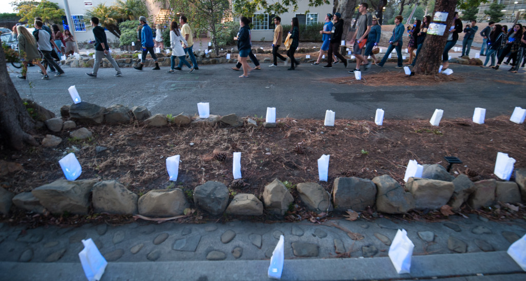 Hundreds of paper bags illuminated with blue LED lights were used to mark the path of the march.