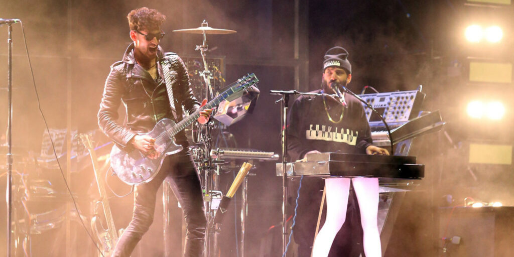 INDIO, CA - APRIL 18:  Musician Dave 1 and P-Thugg of Chromeo perform onstage during day 1 of the 2014 Coachella Valley Music & Arts Festival at the Empire Polo Club on April 18, 2014 in Indio, California  (Photo by Dave Mangels/Getty Images for Coachella)