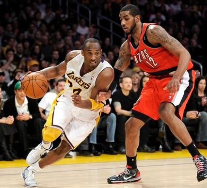 Kobe Bryant drives past LaMarcus Aldridge