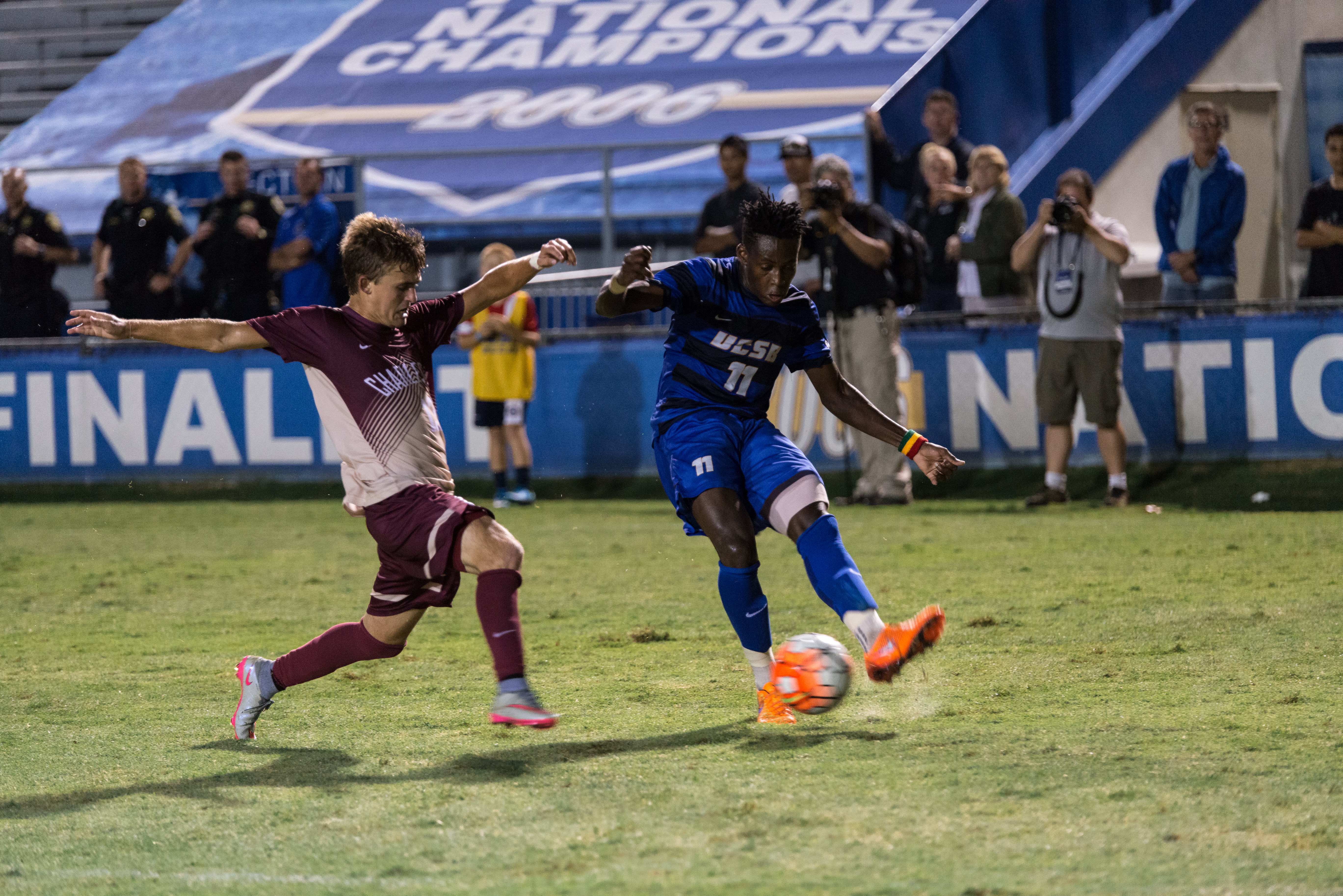 Geoffrey Acheampong crosses the ball after juking past the Charleston defense.