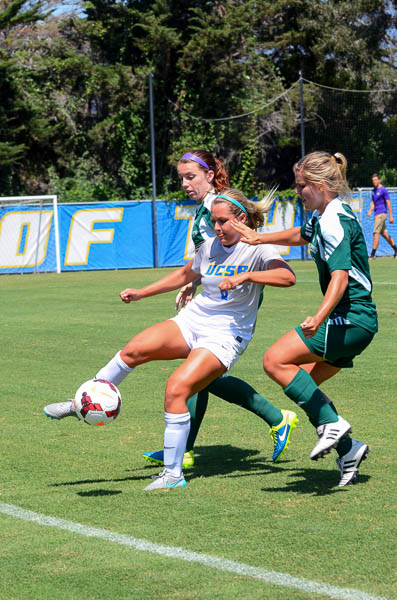 Against Sacramento State, forward Hannah Dearborn pushes the ball past her opponents.