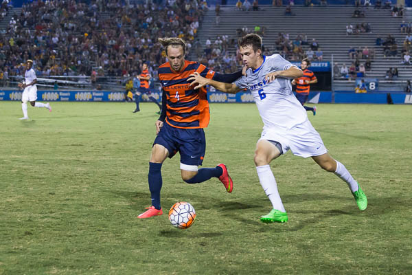 Nick Depuy speeds the ball up the field. Jenny Luo/Daily Nexus
