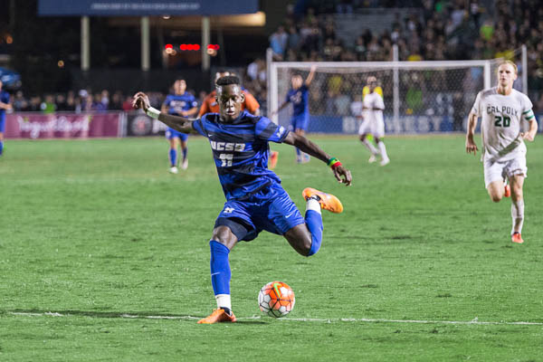 Geoffrey Acheampong plants his foot to take a shot on goal. Eric Swenson/Daily Nexus