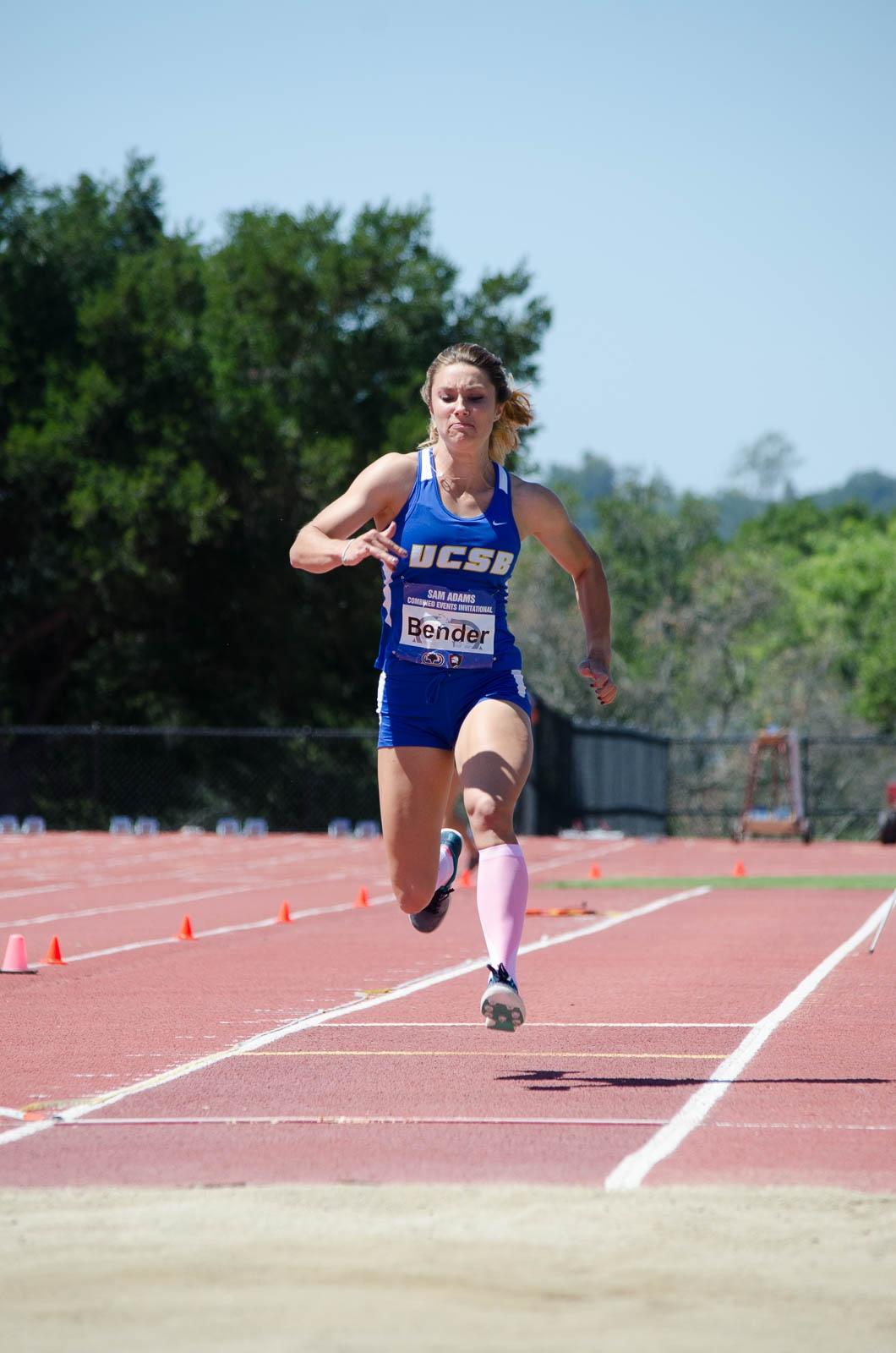 Preparing to jump, Hope Bender runs towards the sand. Christina DeMarzo / Daily Nexus