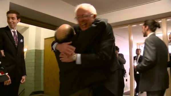 Danny Devito hugging Democratic presidential candidate Bernie Sanders. (Scoopnest.com)