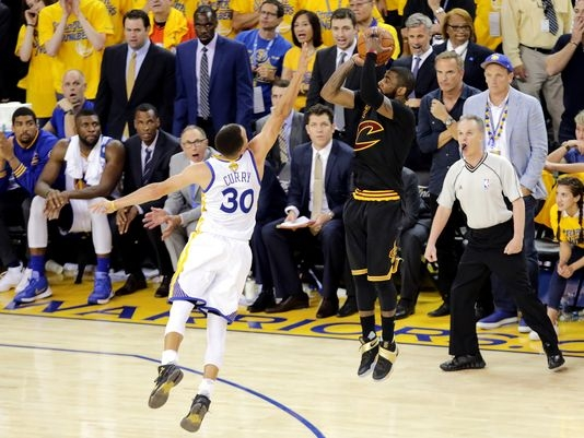 Kyrie Irving's three over Steph Curry with 53 seconds left proved to be the shot that won the championship for the Cavs. Kelley L Cox / USA TODAY Sports