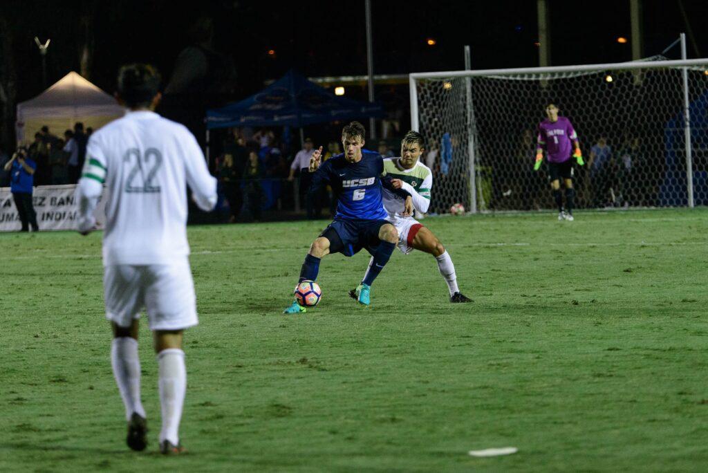 Nick DePuy out-maneuvers the SLO defense. Eric Swenson / Daily Nexus