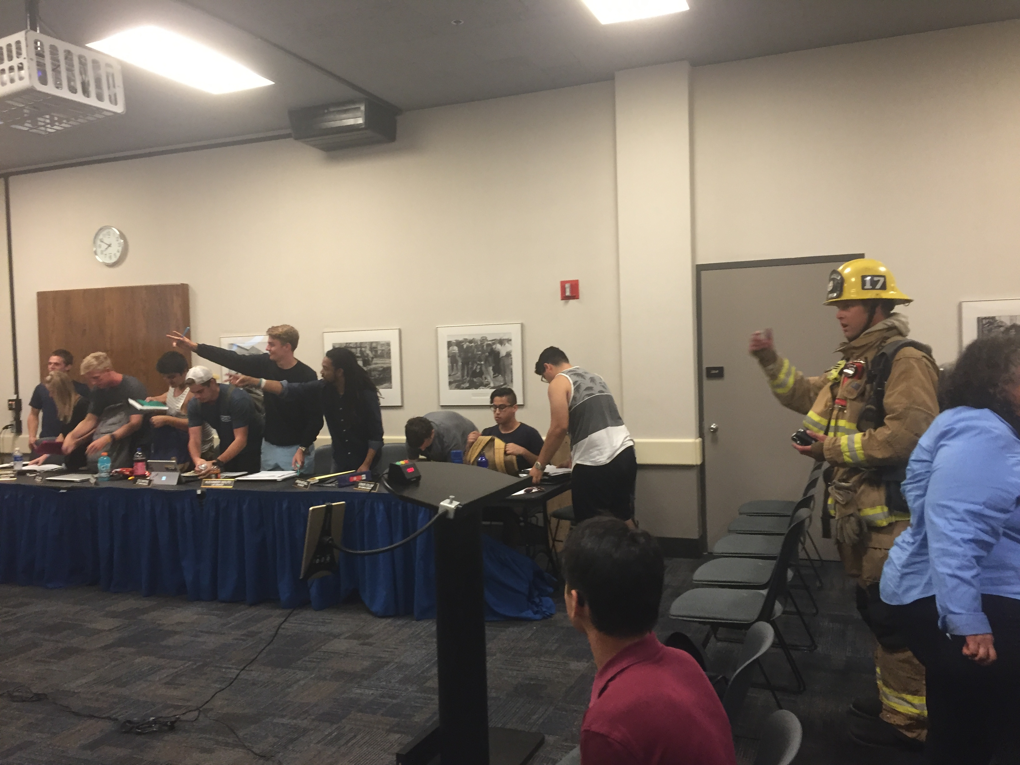 Senators second a motion to end the meeting after firefighters tell meeting attendees to evacuate the building.