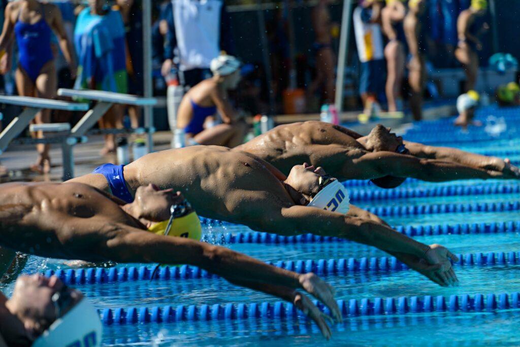 Albert Miao jumps off the block for the men's 100 backstroke. Eric Swenson / Daily Nexus